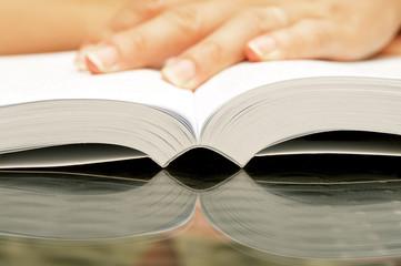 Woman hands holding open book
