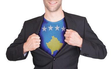 Businessman opening suit to reveal shirt with flag
