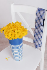 Bouquet of flowers and tie on Fathers Day in room