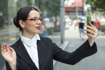 Smiling Woman Capturing A Self Shot