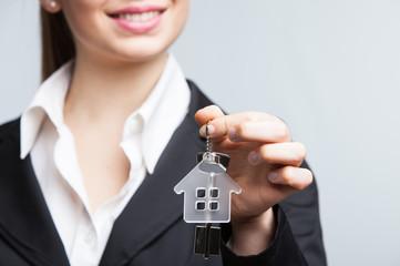 Real estate agent showing keys