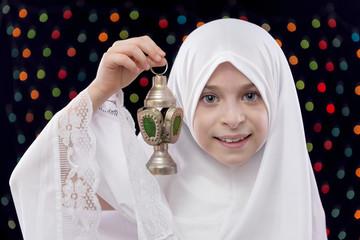 Young Muslim Girl in White Hejab Holding Ramadan Lantern