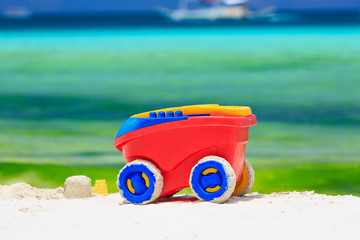 kid toy on tropical beach