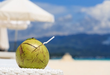 coconut drink on tropical beach
