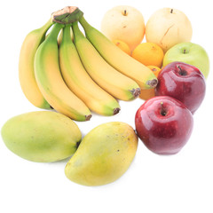 A variety of fruit isolated on a white background, banana, mango