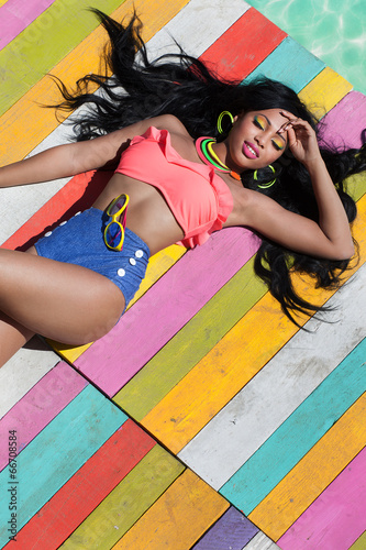 Tropical summer holiday fashion concept woman on wooden pier