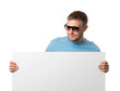 Man in sun glasses holding white billboard on white