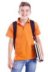 Portrait of a school boy with backpack holding notebooks, isolat