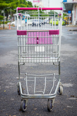 Shopping cart at supermarket parking lot