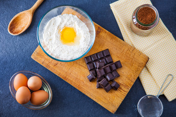 Baking ingredients for a chocolate cake - flour, eggs, chocolate