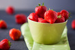 Delicious fresh strawberries in a green bowl