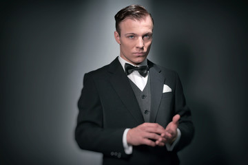 Retro 1920 business fashion man wearing black suit and bow tie.