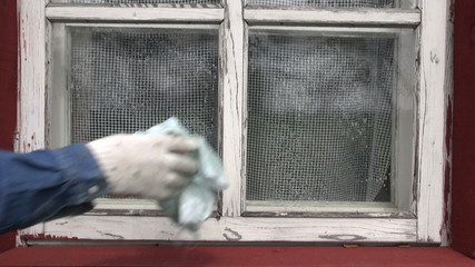 cleaning old window in farm house