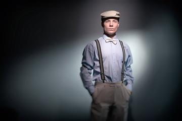 Retro classic dandy fashion man wearing cap with blue shirt brac