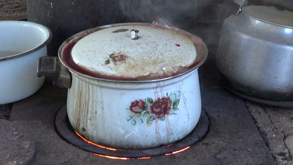 boiling old grunge pot in poor farm kitchen