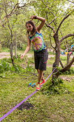 People on the nature walk in the sling and rest - Slackline