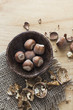 Hazelnuts and walnuts on wooden table