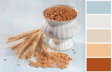 Wheat ears on a wooden background  with complimentary swatches.