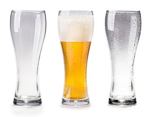 An empty cup, a cup of beer, an empty glass cup on white