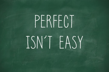 Perfect isnt easy handwritten on blackboard