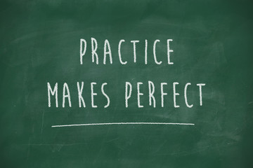 Practice makes perfect handwritten on blackboard