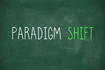 Paradigm shift handwritten on blackboard