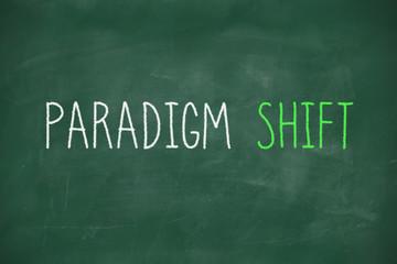 Paradigm shift handwritten on blackboard