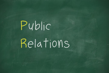 Public relations handwritten on blackboard