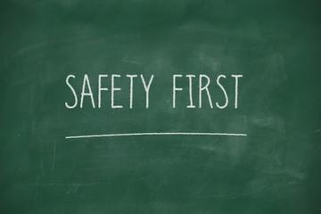 Safety first handwritten on blackboard
