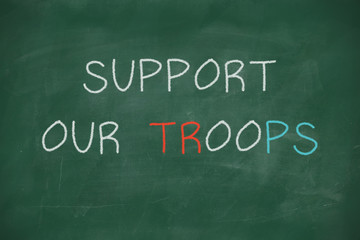 Support our troops handwritten on blackboard