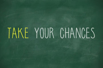 Take your chances handwritten on blackboard