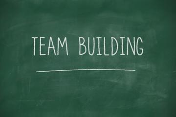Team building handwritten on blackboard