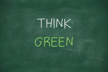 Think green handwritten on blackboard