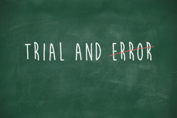 Trial and error handwritten on blackboard