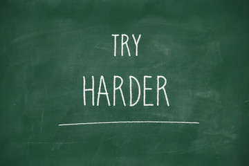 Try harder handwritten on blackboard