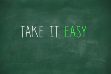 Take it easy handwritten on blackboard