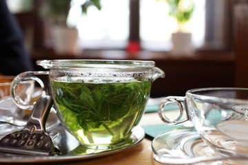 Cup of mint tea on a table