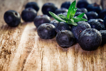 Blueberries on wooden background.