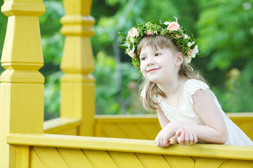 Little pretty girl in white dress