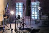 Studio with studio with brick walls and ragged windows