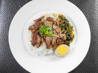 stewed pork leg on rice with boiled egg and preserve