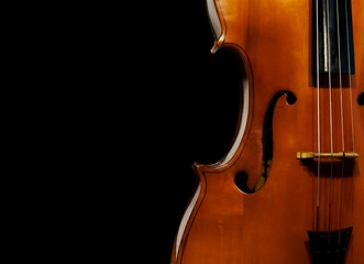 Cello on black background
