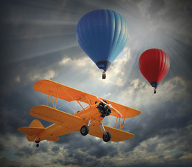 Retro style picture of the biplane and hot air balloons.