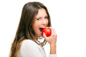 Young woman eating an apple isolated on white