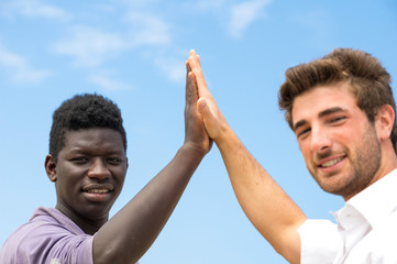 Two men with different skin color