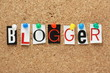 The word Blogger on a cork notice board