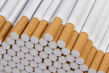 stack of cigarettes on a white background