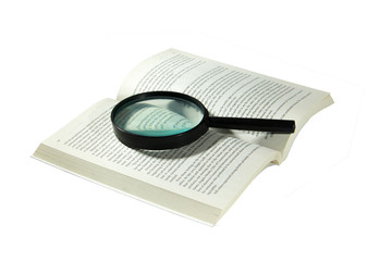 Book and magnifying glass isolated on white background