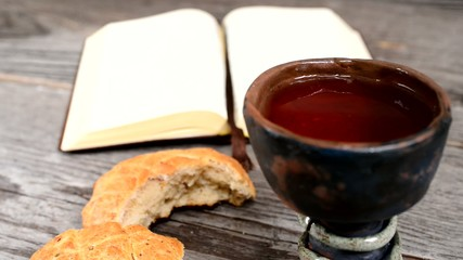 bible with chalice and bread,rack focus
