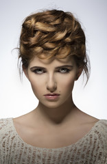 elegant girl with creative hair-style